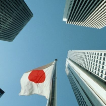 Japan, Tokyo, West Shinjuku, office buildings and flag, low angle view